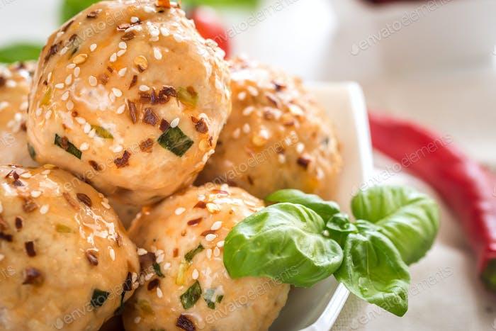 Chicken meatballs under sweet chili pepper sauce