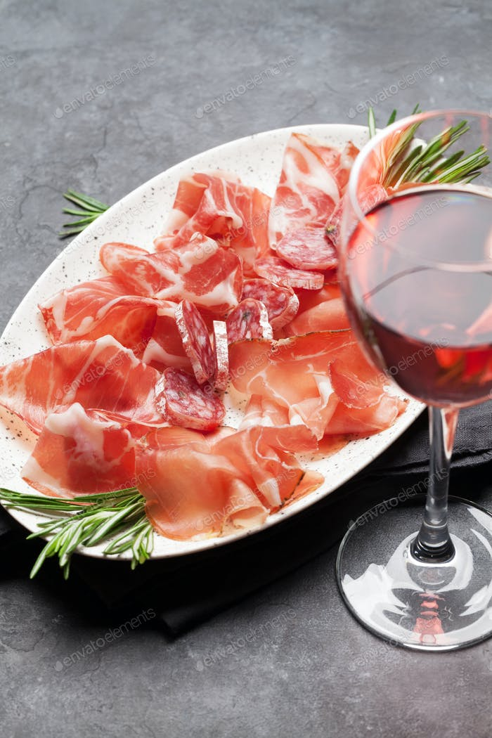 Spanish jamon, prosciutto and wine glass