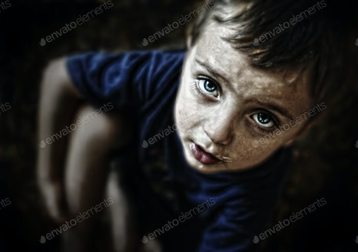 Sad looking child portrait on black background