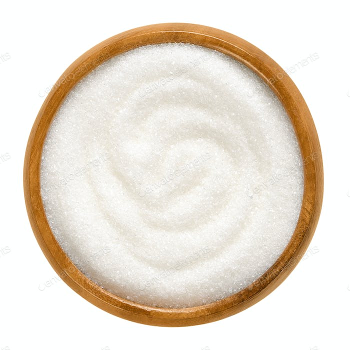 Fine granulated white sugar in wooden bowl over white