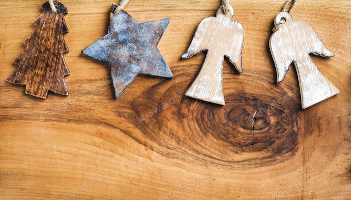 New Year or Christmas background: wooden angels, star and fir-tree over rustic  backdrop, copy space