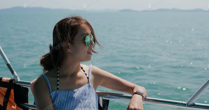 Woman wear sunglass on boat trip