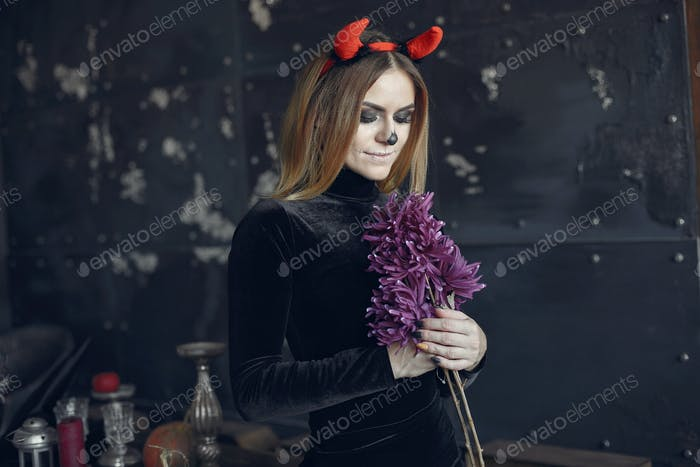 Portrait of smiling woman with Halloween skull make up