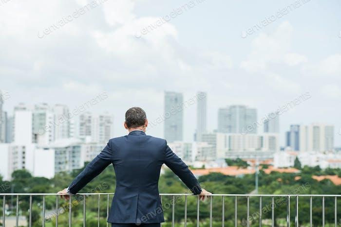 Businessman enjoying cityview