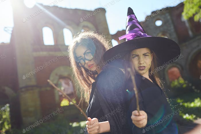 Little Witches Posing on Halloween