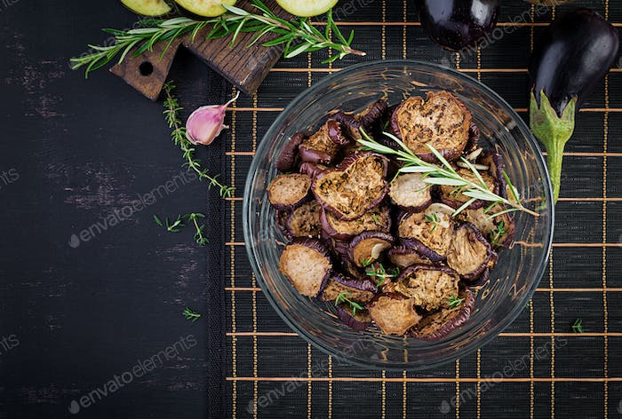 Italian sun-dried eggplant on a dark table. Preserved food. Italian appetizer. Top view