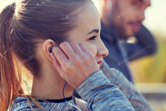 happy woman with earphones listening to music