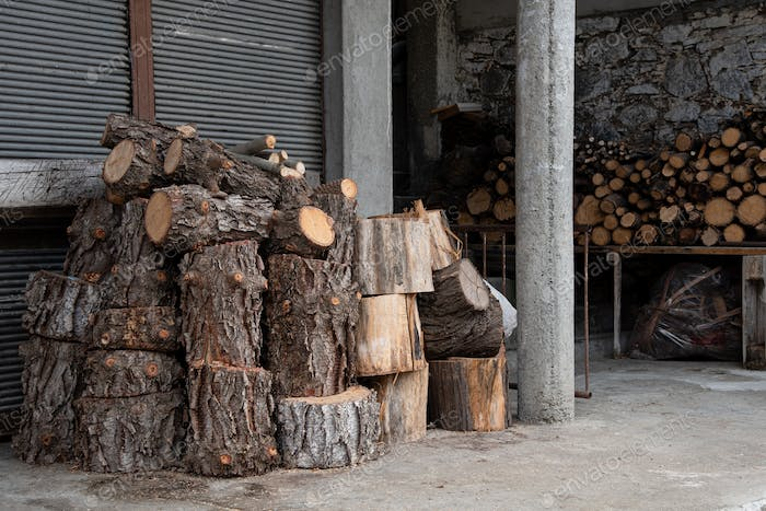 Piles of fire hardwood for a fireplace for heating in wintertime.