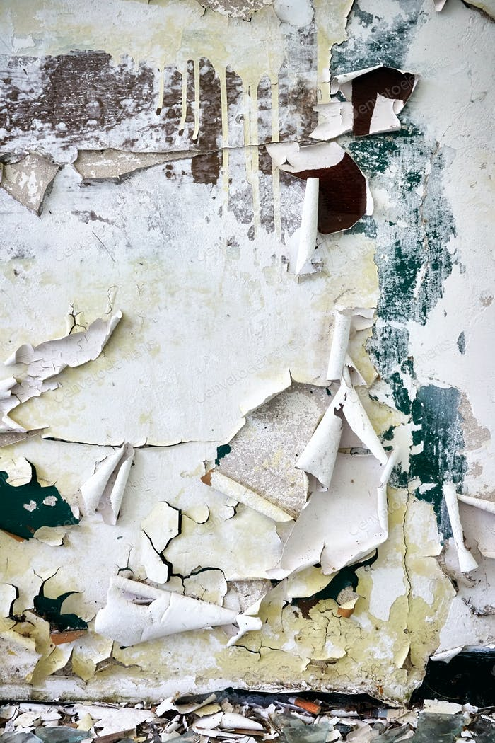 Filthy wall with peeling paint.