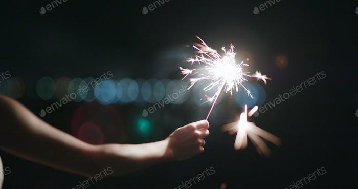 Burning of sparkler at night