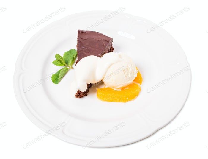 Chocolate cake with ice cream scoop.