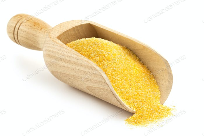wooden scoop with corn flour