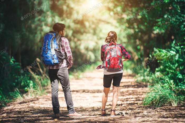 Rear of the couple hiking. Couple adventure travel.