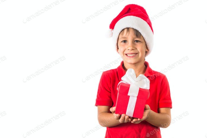 Child boy in christmas Santa hat and red present box on white
