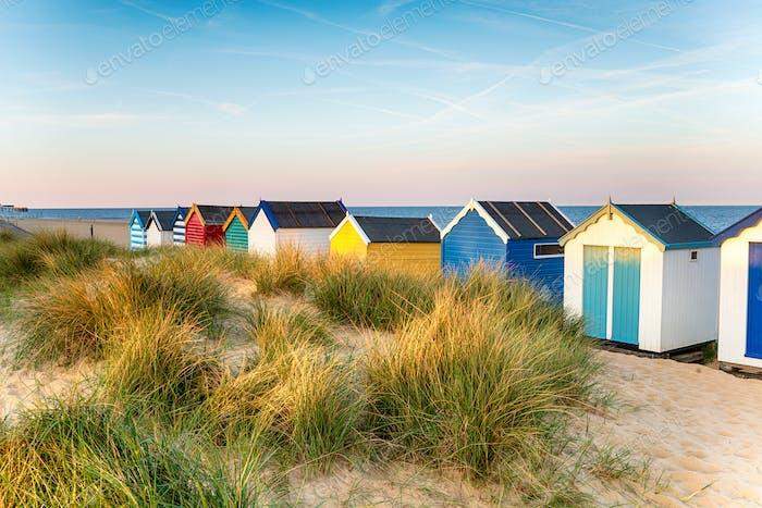 Pretty beach huts in the sand dunes