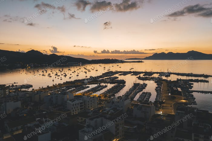 AERIAL View over Golden Sunset in Harbor Bay with Boats in Spain