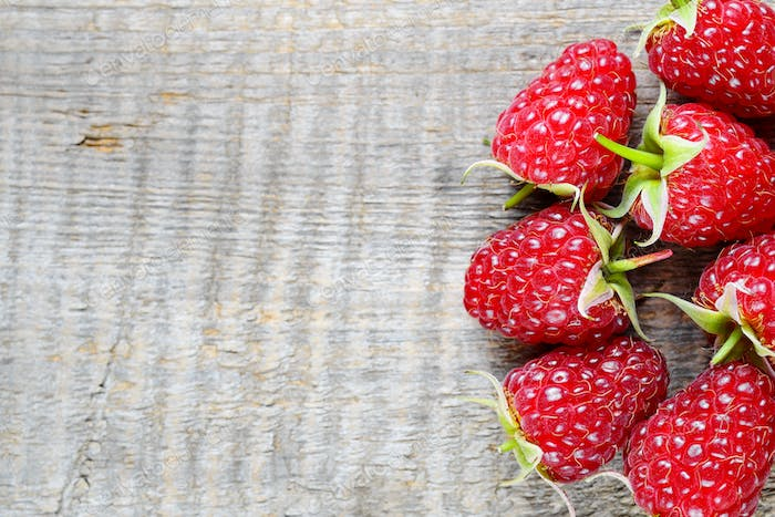 Raspberry close-up on wooden background