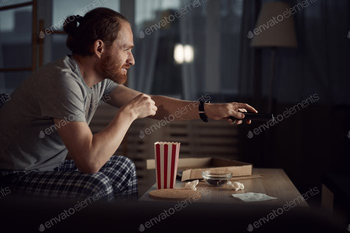 Man Watching Late Night Shows