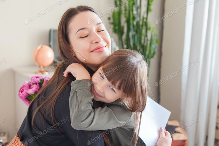 Child congratulates mom on a holiday