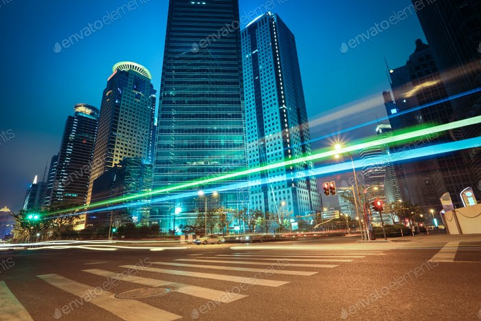 light trails with modern building background at night