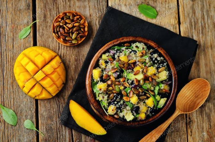 Mango black bean arugula pumpkin seed quinoa salad