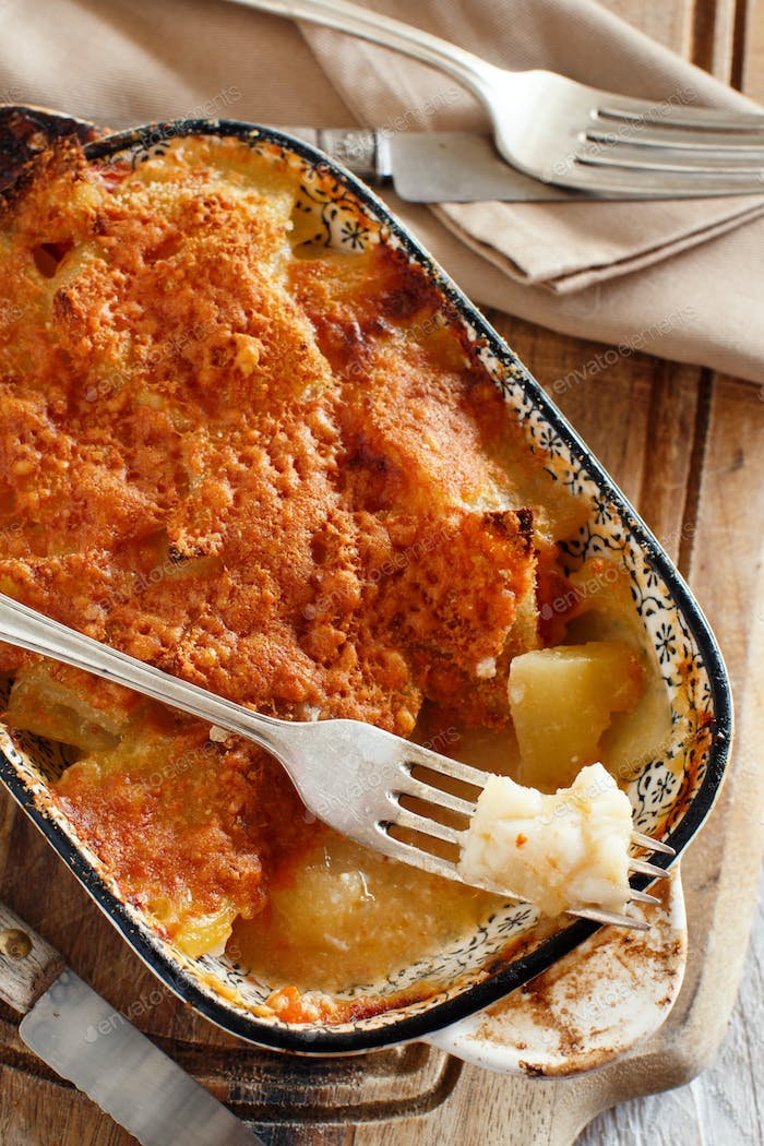 Codfish with potatoes cooked in the oven
