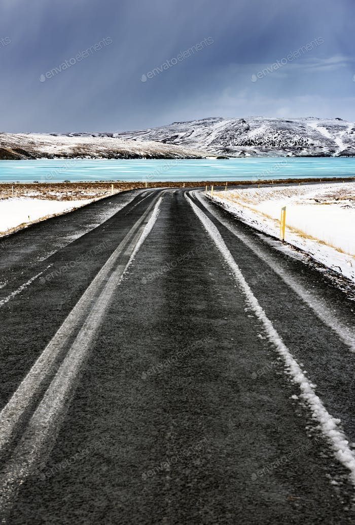 Road along frozen lake