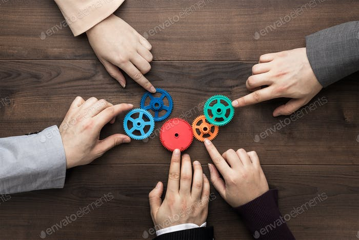 Teamwork Concept On The Brown Wooden Table Background