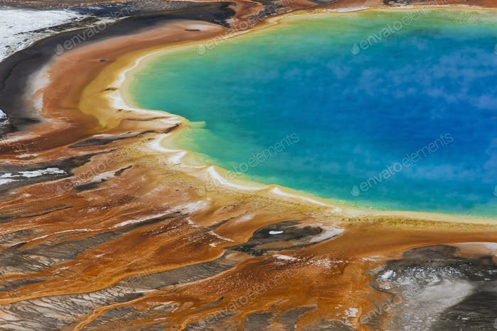 Bright turquoise pool, with mineral deposits
