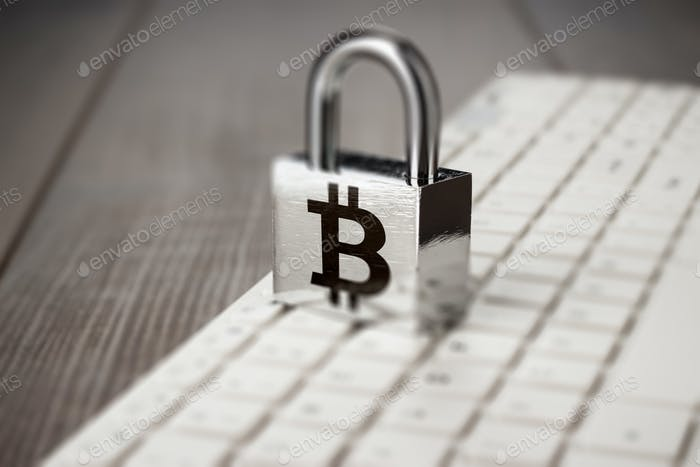 Padlock With Bitcoin Symbol On White Computer Keyboard