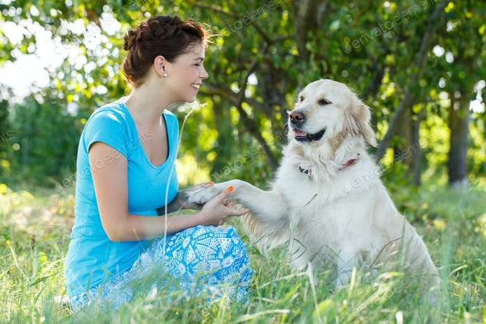 Attractive girl with dog