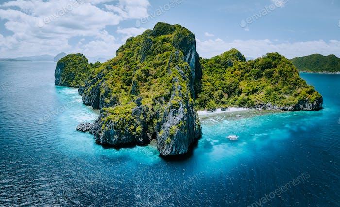 Aerial panorama of tropical paradise Entalula Island and clear blue water El Nido, Palawan