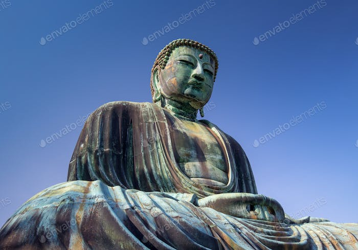 Giant Buddha statue under a blue sky