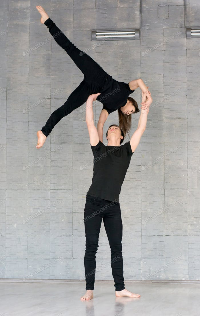 Talented couple practising modern dance.