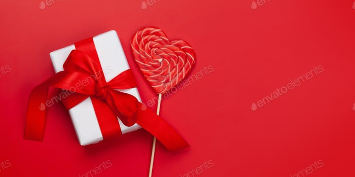 Valentines day. Gift box and heart candy lollipop