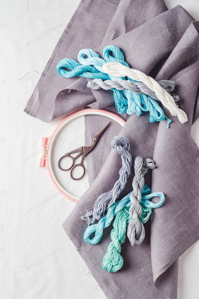 Embroidery set. Linen fabric, embroidery patterns, embroidery hoop, colorful threads and needls.