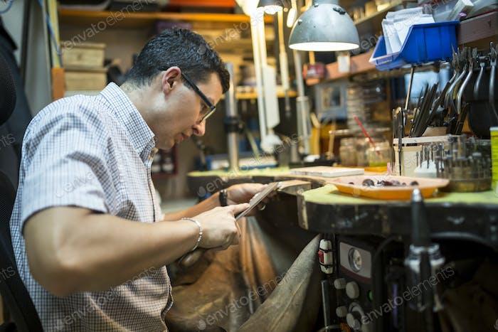 Goldsmith crafting jewelry