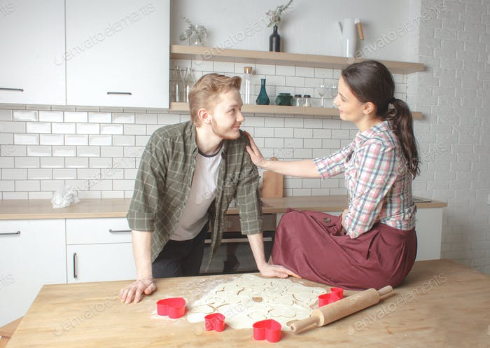 young happy couple at home kitchen interior