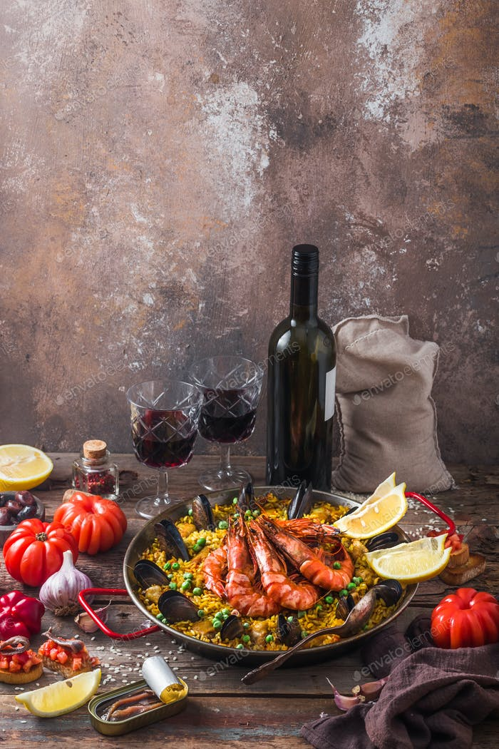 Spanish paella with seafood in a pan with copy space