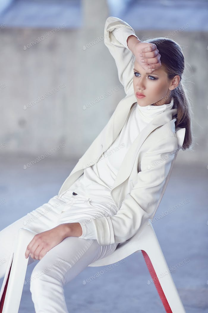 Blue eyes young woman in a white clothes.