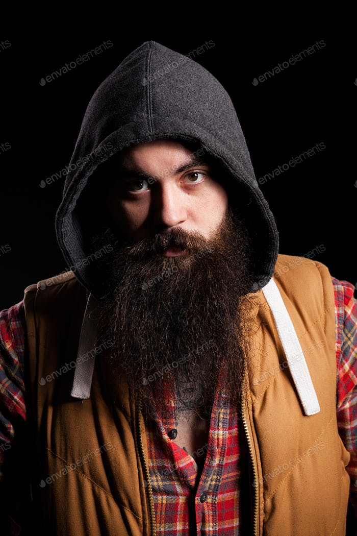 Hipster bearded man wearing a hood