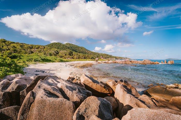 La Digue, Seychelles. Beautiful remote tropical beach. Ocean coast, unique granite rocks and blue