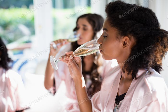 Women drinking a glasses of champagne