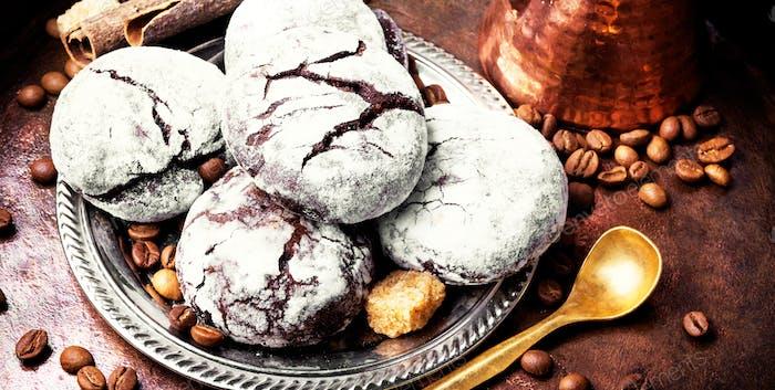 Chocolate homemade cookies with cracks to coffee