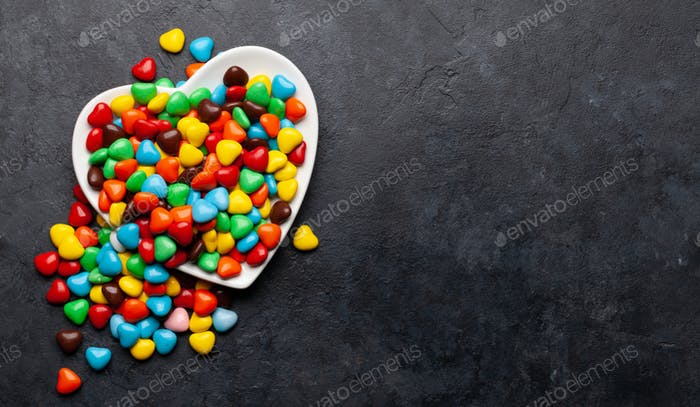 Heart shaped candies. Valentines day card