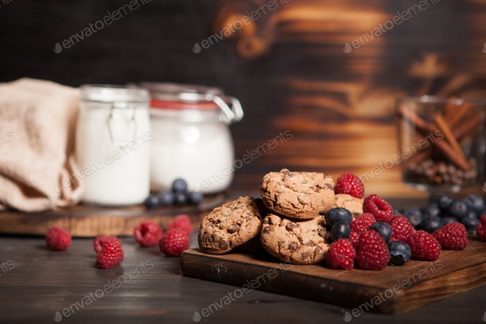 Tasty and delicious chocolate chips on wooden plate