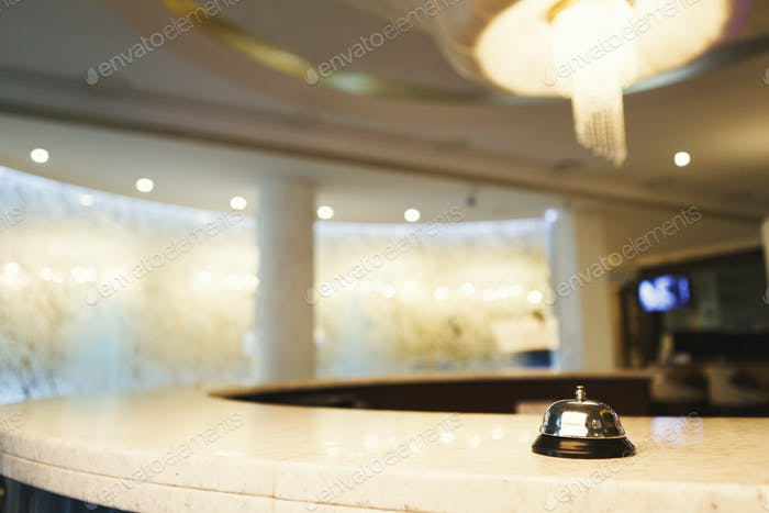 Hotel accommodation call bell on reception desk