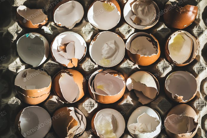 Texture of broken empty eggshell in carton box. View from above