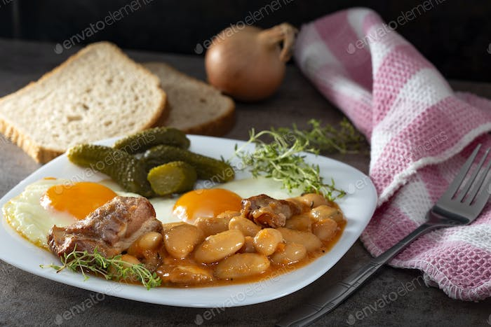 Beans with smoked pork meat, eggs and pickles