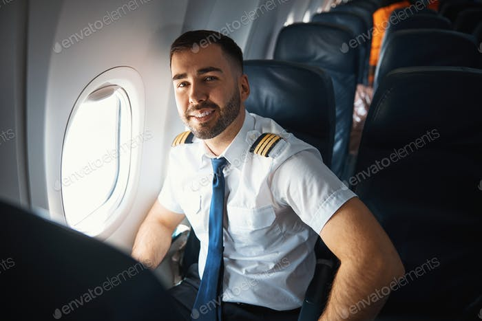 Satisfied pilot after checking the airplane cabin